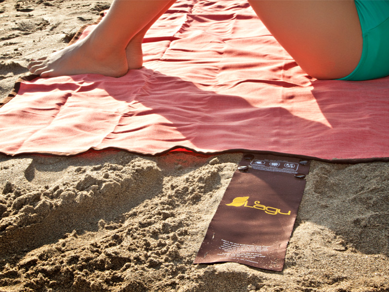 Lagu Beach Blanket Sitting on Sand