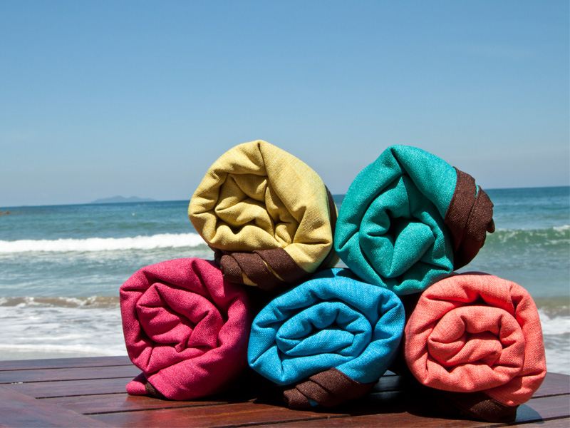 Lagu Beach Blankets Rolled on Table Sea Background