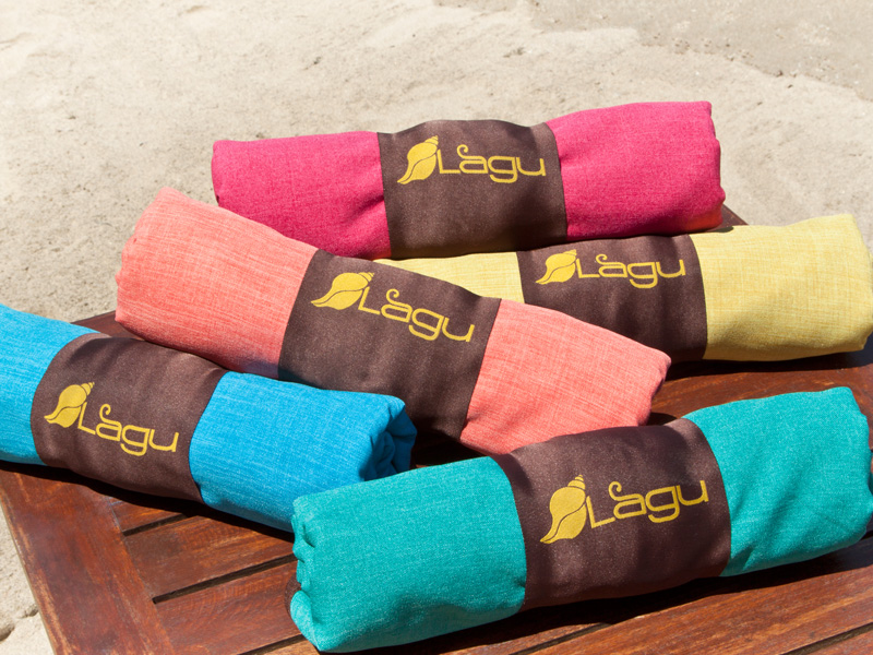 Lagu Beach Blankets Rolled on Table